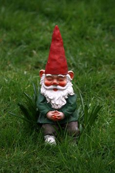 "A napping gnome. Kind of looks like my ""Nestor Qui Dort"" from the Kiss That Frog yellow gnome kitchenware line. Only tree trunk not included!"