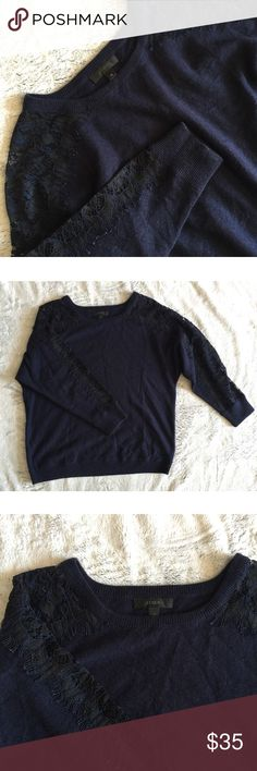 J. Crew Blue Wool Sweater Lace Sleeves Gorgeous dark navy blue soft sweater with see-through lace sleeves. A beautiful addition to your winter wardrobe❄️Wool, Nylon & Viscose  ✔️If you'd like to MAKE AN OFFER please do so through the offer button ONLY. I won't negotiate prices in the comments.  ✔️All items $15 and under are firm unless BUNDLED.  ❌No trades, PayPal, Holds 📷Instagram: @lovelionessie J. Crew Sweaters Crew & Scoop Necks