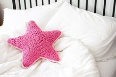 """This crochet star pillow using beautiful We Are Knitters fabric yarn is a """"siriusly"""" fun project to whip up over the weekend!"""