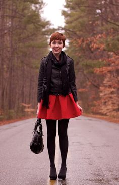 The slightly masculine leather jacket paired with the ultra feminine red a-line skirt create an awesome contrast. I need to get me one of those black leather jackets.