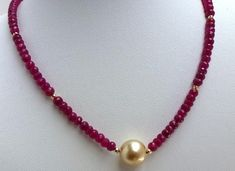 Ruby bead necklace with large golden south sea pearl. Pearl Necklace Designs, Gold Earrings Designs, Handmade Jewelry Designs, Gold Jewellery Design, Bead Jewellery, Jewelery, Beaded Necklace, Ruby Necklace, Gemstone Necklace