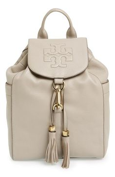 Free shipping and returns on Tory Burch 'Thea' Backpack at Nordstrom.com. A textbook example of street-savvy style, the Thea backpack boasts gleaming hardware, richly textured leather, swingy tassels and a quilted logo—not to mention a roomy interior and multitude of pockets.