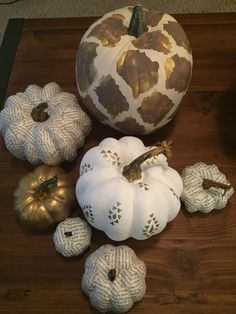 I love pumpkins! Gold and white painted pumpkins. Tribal print book page modpodge