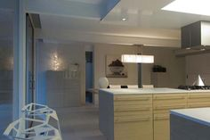 Modern Kitchen Design Ideas With White Theme Desk And Storage With Romantic Hanging Lighting Tips on renovating a house to modern style other design ideas