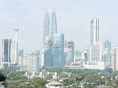 吉隆坡房價走揚,打工族只好越住越遠。