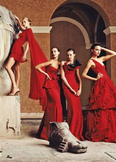 Four ladies in glamorous red gowns