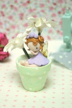 Fairy Figurine in a flower pot