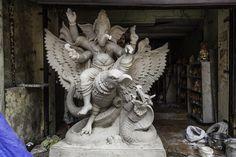 Ganesh idol with Ganesh sitting on avulture hunting snake