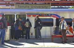 And still they come; Temple University SEPTA stop; Philadelphia, Pennsylvania, USA.  September 2013.