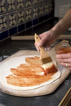 Paint the sauce onto cracker-crust pizza