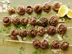 Stuffed-Mushroom Skewers : Stuffed mushrooms are an all-time favorite appetizer. Slide them onto a skewer and pop them on the grill for your next outdoor gathering. For a zesty spinoff, try substituting fresh chorizo and cilantro for the sausage and parsley.