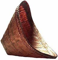This type of conical shaped natural bamboo basket is used to steam sticky rice in the North and North East of Thailand. Paired with a pot of boiling water, sticky rice is easily and authentically prepared. TempleofThai.com $6.00