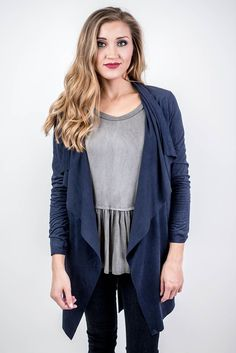 You will be styling our Navy Suede Tie Waist Cardigan with everything! Pair it with a basic tee and skinny jeans for a campus class look or an outfit for a day at the pumpkin patches or the orchard! Navy Suede Tie Waist Cardigan - Single Thread Boutique, $38.90 #deep #navy #faux #suede #tie #waist #cardigan #trendy #chic #long #sleeves #cascading #tie #cute #fall #jacket #sheen #womens #fashion #fall #winter #singlethreadbtq #shopstb #boutique
