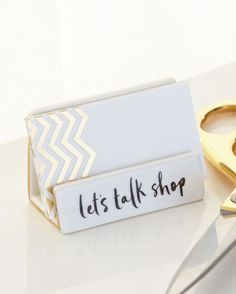 Who wouldn't want to talk shop with whoever sits behind the desk of this chic business card holder?
