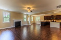Living room with fireplace and laminate flooring in the Potter Craftsman KS