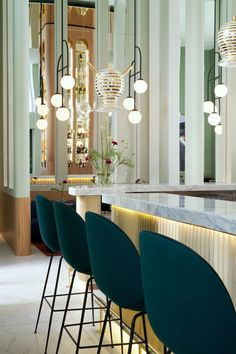 Jaime Hayon at Barceló Torre de Madrid Hotel. In the bar, a series of Romanesque arch-shaped windows offer views of the city, while golden glazed ceramics hang from the ceiling.