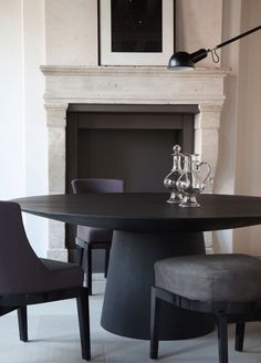 UFO dining table by Emmemobili with marvelous upholstered chairs. 10 Gorgeous Black Dining Tables for Your Modern Dining Room ♥ Discover the season's newest designs and inspirations. Visit us at www.moderndiningtables.net #diningtables #homedecorideas #diningroomideas @ModDiningTables