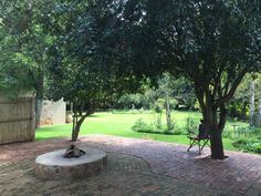 Treelands Estate Unit Outside patio with fire lapa overlooking garden.