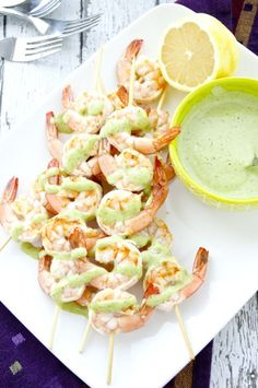 Tender shrimp are tossed with olive oil and lemon juice, skewered, and then grilled to juicy perfection. Serve alongside a flavorful arugula pesto aioli for dipping. This easy dish can be served as an appetizer or as a main dish over a green salad or alongside a bowl of soup. {Whole30 & Paleo!}