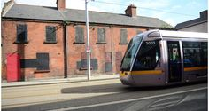 A Luas tram passes a derelict terrace of redbrick houses on Benburb Street in North inner city Dublin. Derelict Buildings, Urban Exploration, Buses, Urban Decay, Dublin, My Dream, Abandoned, Trains, Terrace