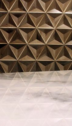 A closeup of the DIY Wood Tiles. They come in single diamond shaped pieces so you can make any design you wish.