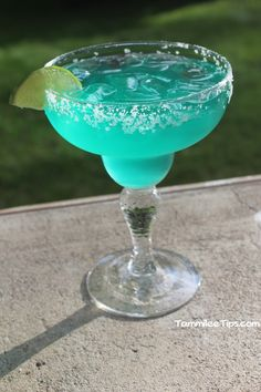 Blue Agave Margarita Recipe:  1 1/2 oz Silver tequila 1/2 oz Triple Sec 1/2 oz Blue Curacao 1/2 cup Sweet and Sour