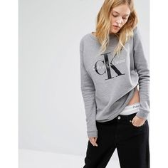Calvin Klein Jeans Logo Sweatshirt (525 SAR) ❤ liked on Polyvore featuring  tops, 282ab29d12