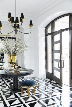 A sophisticated and elegant entryway can set the tone for the rest of a home, designed by Jessica Bennett.