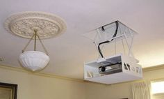 Home Theatre Projector Mounted On A Display Shelf Wires