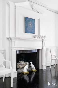 Louis Ghost chairs designed by Philippe Starck for Kartell flank the dining room fireplace, which showcases high-profile traditional-style molding. A painting by Barbara Takenaga from Gregory Lind Gallery in San Francisco adds a dose of color; vintage dog sculptures inject a playful note.