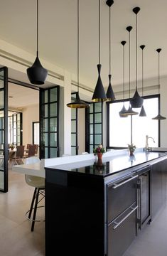 Villa-Yarze-Raed-Abillama-Architects-9 black kitchen island with different black hanging lights
