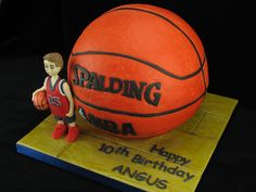 A chocolate mud cake basketball with a figurine of the birthday boy. The basketball is a life sized junior size 5 ball