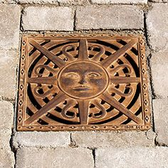 "Designer Cast-iron Drain Covers from Iron Age Designs ""Standing on tiptoe, he placed his hands on th Iron Age, Shower Drain, Shower Floor, Drainage Grates, Tree Grate, Outside Showers, Trench Drain, Drainage Solutions, Drain Cover"