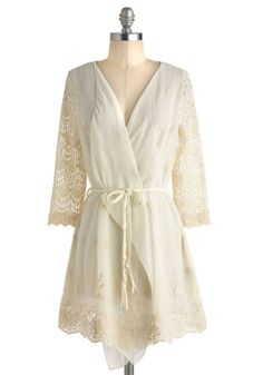 Pretty ivory cardigan with crochet sleeves and trim.  I like that it could be worn open or tied at the waist.