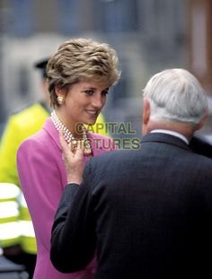 February 14, 1994: Princess Diana arriving to open a newly refurbished wing at Great Ormond Street Hospital for Sick Children in Central London. This is the only listed official engagement of the year and around 200 people braved the snow and icy winds to greet her arrival. The normal police outrider motorcycles were cancelled due to icy roads created by temperatures as low as 5C (23 degrees F.) that had swept Southern England.