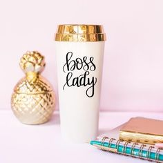 Every boss lady needs an assistant that will get her through the day - and our motivational Boss Lady Travel Mug will do just that for you! Hustle through your to-do list and meetings with chic style! This tumbler features a beautiful gold lid +hand writtendesign and makes theperfect desk accessory! 16oz Insulated Plastic Travel Mug, Shiny Gold Foil Screw On Lid With Slide Closure,HandWritten Design,BPA, Phthalate, + Lead Free,Hand Wash + Do Not Microwave