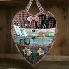 Little heart hanger for tools in use.  Can hang this on my chair. I need a hook on the wall to put it up so that darn dog can't get them.