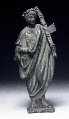 An ancient Roman bronze figure of a lictor (magistrate's attendant, carrying a fasces. (British Museum)