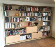 Combining 18 and 24mm Birch plywood drawers and open shelving. Built in to this open plan living style house. A beautiful way for the owners to display their art and books.