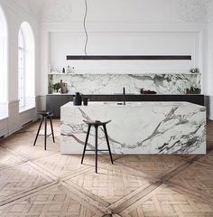 Baroque and modernist touch in an open kitchen for workshops | French oak wood woof parquet by Cabuy Didier | Marble kitchen island and countertop | long flat base lighting