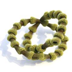 Beautiful green bracelet by Tzuri Gueta. Silicone & silk, Gallery Lulo.