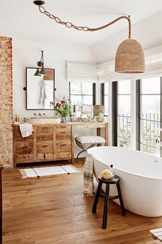 Warm bathroom uses a mix of exposed brick, wicker and natural wood in this home Warm Bathroom, Bohemian Bathroom, Bathroom Ideas, Rental Bathroom, Bathroom Trends, Bathroom Designs, Bathroom Storage, Bathroom Interior Design, Home Interior