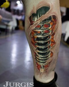 Shock Absorber Biomechanical Tattoo http://tattooideas247.com/shock-absorber/