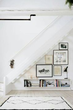 Nice use of Art in space under stairs! Domino magazine shares storage tips for the space under the stairs. How to decorate the empty space under the stairs. Elle Decor, Style At Home, Home Deco, Space Under Stairs, Open Stairs, White Stairs, Under The Stairs, Floating Stairs, Under Staircase Ideas