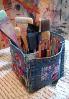 Denim Studio Box Tutorial: blue jean pockets make great art supply containers, especially when several are stitched together.