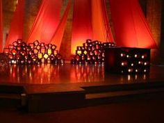 triangles of fabric + stacked boxes w/ candles - Taize