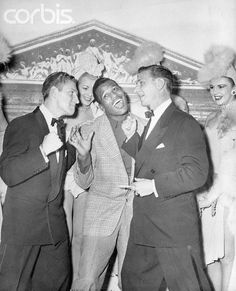 "Sugar Ray Robinson Jokes with Singing Team  Original caption:11/21/1950-Paris, France- World welterweight boxing champion ""Sugar"" Ray Robinson gives up before the threatening rights of the Bernards, a song and dance team performing at a Paris nightclub. In Paris to fight Jean Stock, Sugar spent his first night visiting the Champs-Elysees Club."