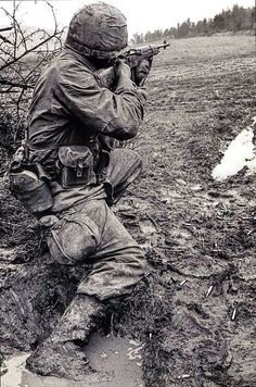 Marine with M-14 rifle. - Vietnam War, really! look at all the brass on the deck…