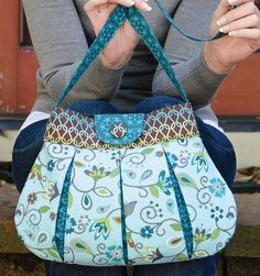 Betz White's purse pattern is darling!  I love her book Warm Fuzzies, chock full of projects for felted wool sweaters.