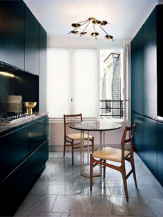 A sparse kitchen is the perfect scene for this impactful overhead light.